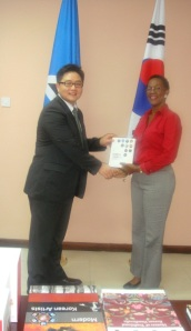 Mr. Sang Hoon Lee makes donation of Korean books to the Director of Central Library, Ms. Brenda Paul
