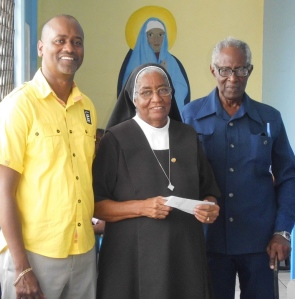 LIME GM Chris Williams and Mr George Theophilus flank Sisterr Olivia Oculien of the Marian Home