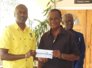 LIME GM Chris Williams presents to Adelaide & Frances Memorial Home founder and director Augustus Justin whilst Mr Theophilus looks on